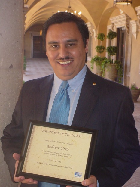 Ortiz with VSUW Award in courtyard